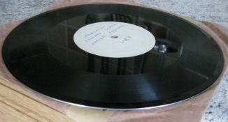 Acetate disc: note shiny edge and centre hole